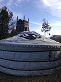 A view of the yurt from behind with the village church