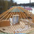 Yurt framework being installed onto the platform.